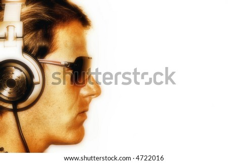 Side profile of a cool DJ wearing sunglasses and headphones. - stock photo