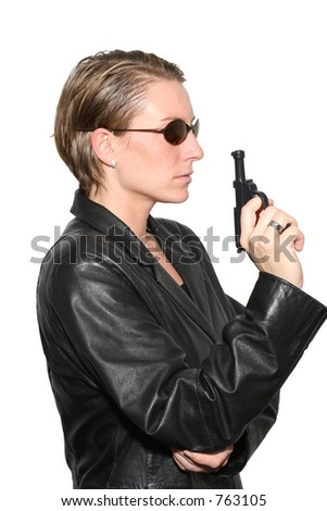 Side profile of a cool female spy - stock photo