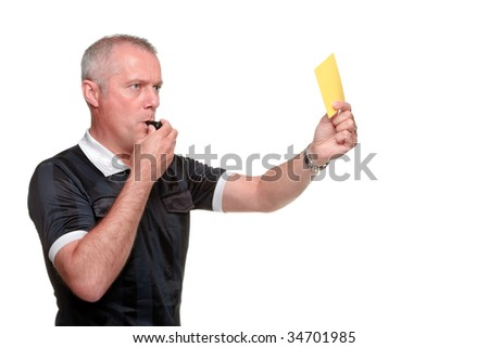 Side profile of a referee showing the yellow card, isolated on a white background. - stock photo