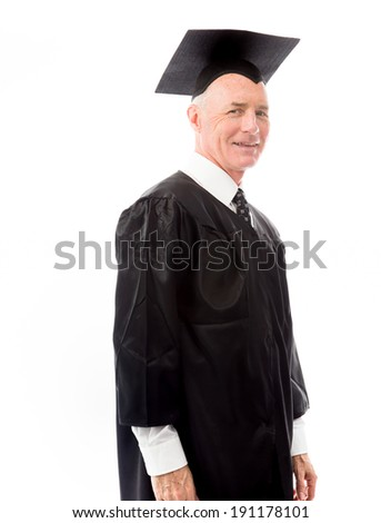 Side profile of a senior male graduate smiling