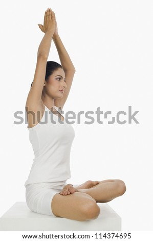 Side profile of a woman practicing yoga - stock photo