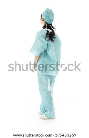 Side profile of an Asian female surgeon looking up - stock photo
