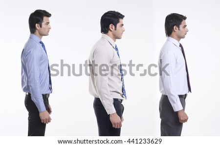 Side profile of male executives