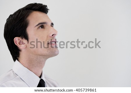 Side profile portrait of a businessman looking happy