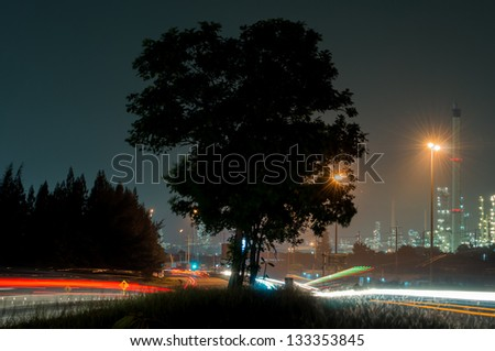 Side refinery with car light  at the dusk - stock photo