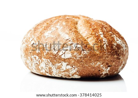 Side shot closeup on wholemeal or wholegrain bread roll, isolated on white background.