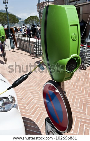 Side shot of a bright green electric car charger in Monaco. - stock photo
