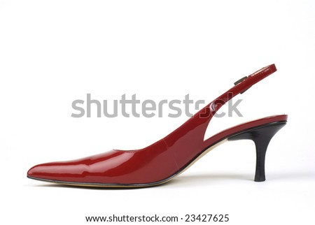 Side shot of one red women's high-heel dress shoe against white background - stock photo