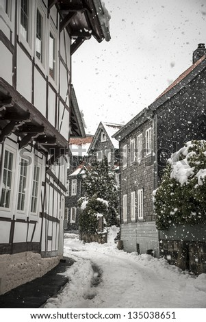 Side street with half-timbered houses in the winter with snow