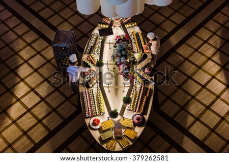 SIDE, TURKEY - JUNE 24, 2015: Hotel restaurant chefs prepare a desert buffet for guests. - stock photo