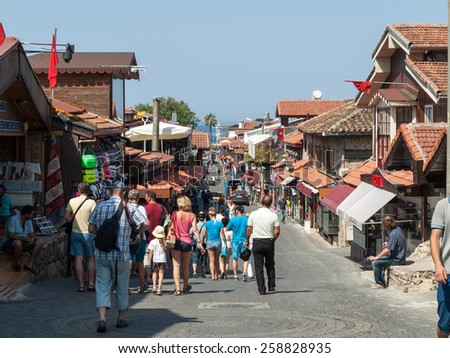 SIDE, TURKEY - JUNE 18, 2014: Shopping street in the seaside town. Anatolian coast - a popular holiday destination in summer of European citizens. - stock photo
