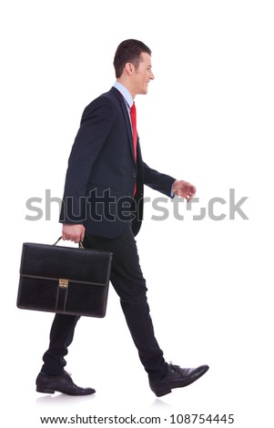 side view business man holding brief case and walking over white background - stock photo