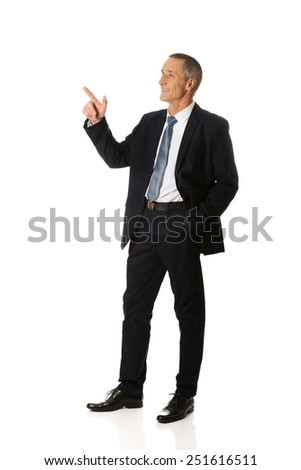 Side view businessman pointing upwards.  - stock photo