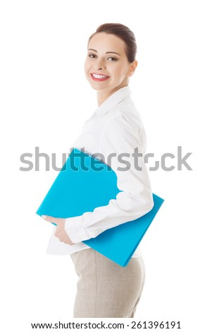 Side view businesswoman holding binder. - stock photo