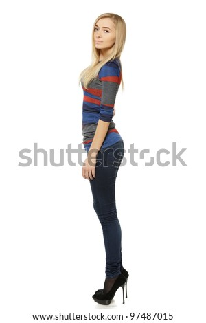 Side view full length of young female in casual standing over white background