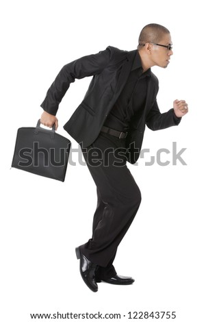 Side view image of a young businessman with briefcase running on a white background