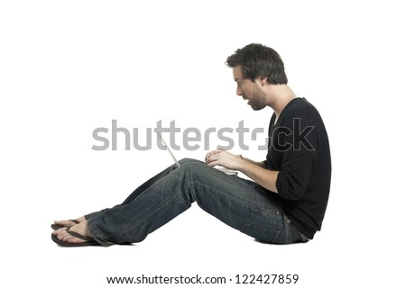 Side view image of busy man holding a laptop while sitting on white background
