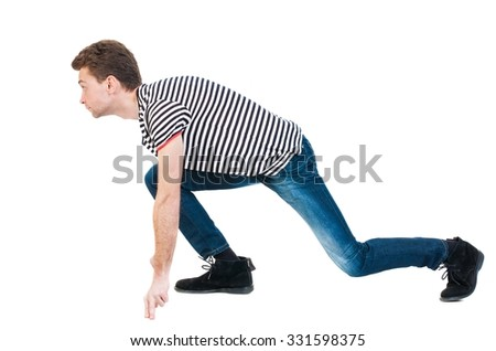side view man start position.  Rear view people collection.  backside view of person.  Isolated over white background. The guy in the striped shirt is getting ready for a sprint. - stock photo
