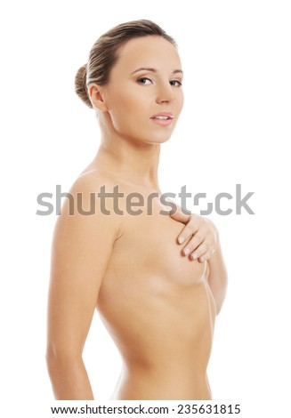 Side view nude woman covering her breast.