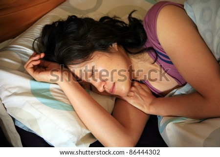 Side view of a asian woman sleeping in bed