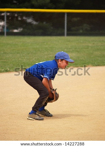side view of a baseball player in the infield - stock photo