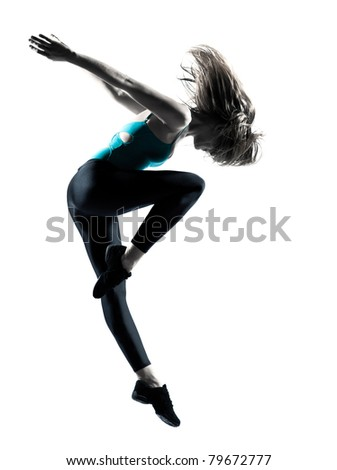 Side view of a beautiful young female dancer showing her dancing skills on white background - stock photo