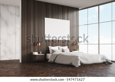 side view of a bedroom interior with a king size bed wooden and marble walls