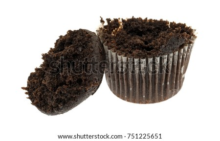 Side view of a bite size chocolate muffin with the top broken off isolated on a white background.