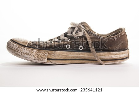 Side view of a brown old dirty trainer - stock photo
