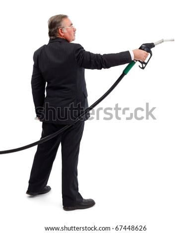 Side view of a business man, pointing with gas nozzle
