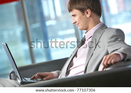 Side view of a businessman working on computer - stock photo