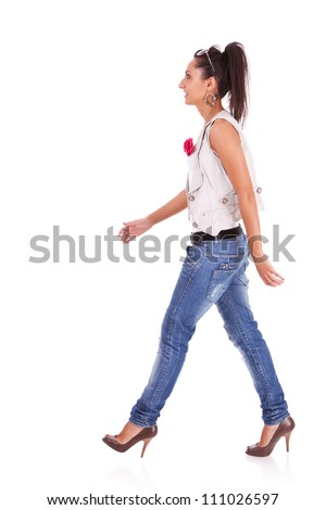 side view of a casual woman walking isolated over a white background