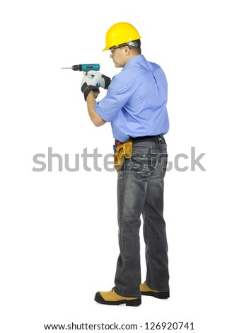 Side view of a construction worker wearing hard hat with hand drill