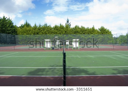 side view of a court of tennism chair of the referee and players - stock photo