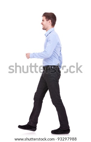 side view of a fashion man walking forward over white - stock photo
