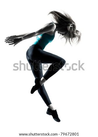 Side view of a flexible young female dancer jumping on white background - stock photo
