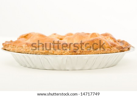 Side view of a golden apple pie