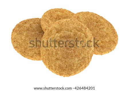 Side view of a group of baked snickerdoodle cookies isolated on a white background. - stock photo