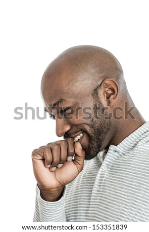 Side view of a handsome late 20s black man laughing isolated on a white background