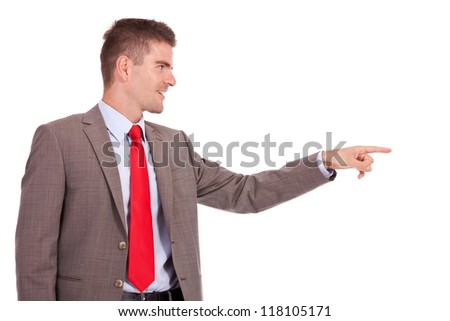 side view of a handsome young business man pointing and looking to his side. isolated on white