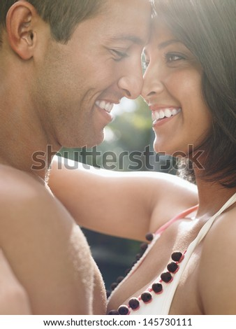 Side view of a happy young couple standing face to face
