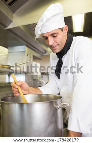 Side view of a male chef preparing food in the kitchen