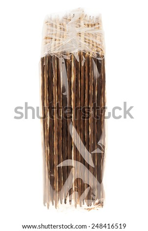 Side view of a nylon wrapped package of Jewish Matzah bread, the substitute for bread on the Jewish Passover holiday, isolated on white background. - stock photo