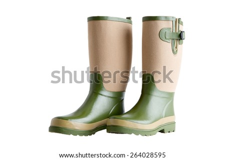Side view of a pair of stylish garden boots in two-tone green and beige with adjustable gussets standing upright side by side isolated on white - stock photo