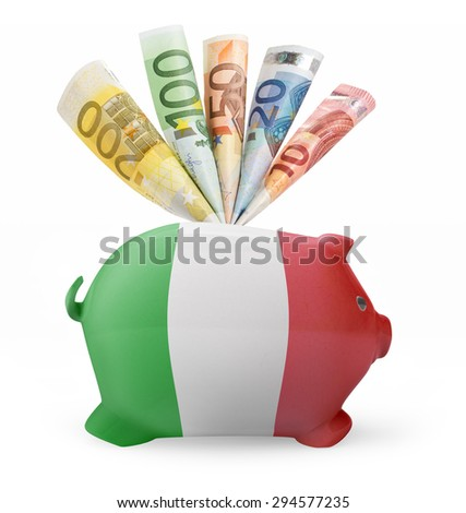 Side view of a piggy bank with the flag design of Italy and various european banknotes.(series) - stock photo
