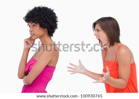 Side view of a quarrel between two teenagers - stock photo