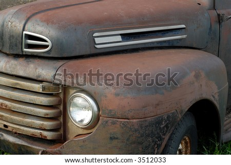 side view of a rusted out vintage pick up truck - stock photo