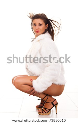 side view of a sexy woman in white fur coat - stock photo