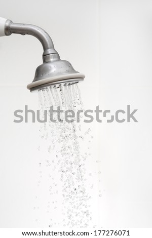 side view of a shower head with running water - stock photo