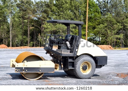 Side view of a small soil compactor at rest - stock photo